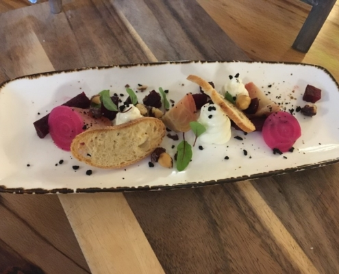 Ardsallagh goats cheese, roasted and pickled beetroot, black olive clay, hazelnuts