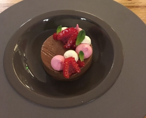 Chocolate and caramel mousse textures of raspberry, hazelnut praline cream