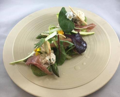 Crab mayonnaise textures of asparagus, jamon Iberico, pesto, garden leaves