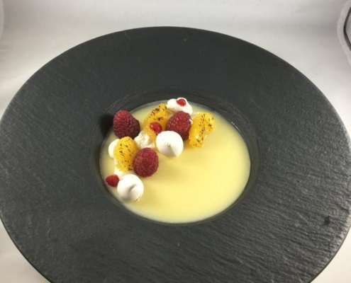 Lemon posset charred grapefruit, raspberries, meringue kisses
