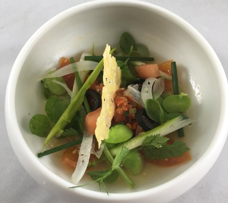 Tomato Consume broad beans, black olive, summer herbs and parmesan