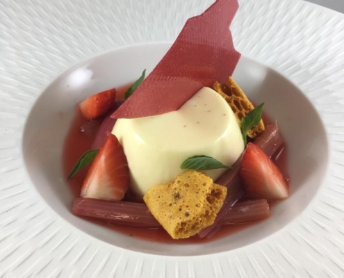 Vanilla panna cotta strawberries, poached rhubarb, and honeycomb
